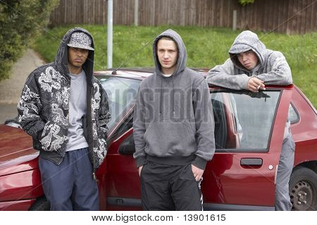 Group Of Young Men With Cars