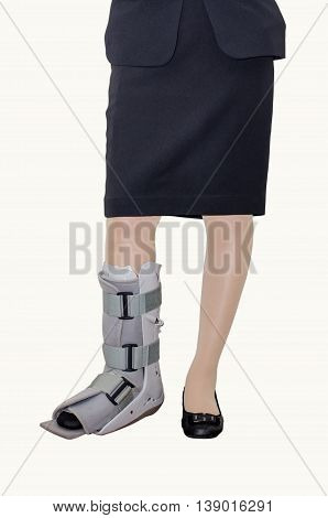 Business woman in suit with an ankle brace