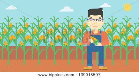 An asian farmer holding a corn cob. Young farmer standing on the background of corn field. Vector flat design illustration. Horizontal layout.