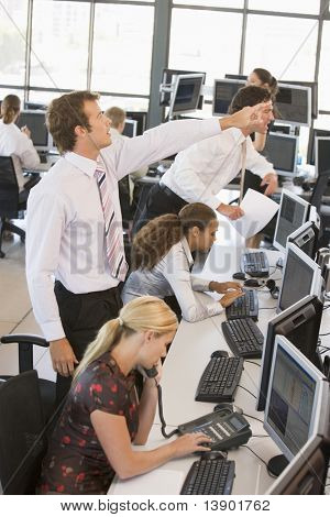 High Angle View Of Stock Traders At Work