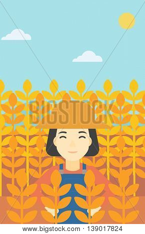 An asian female farmer standing in a wheat field. Young farmer working in a weat field. Vector flat design illustration. Vertical layout.