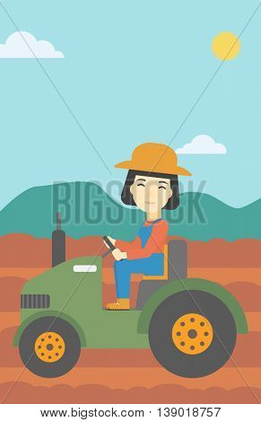 An asian female farmer driving a tractor on the background of plowed agricultural field. Farmer sitting on a tractor in the countryside. Vertical layout.