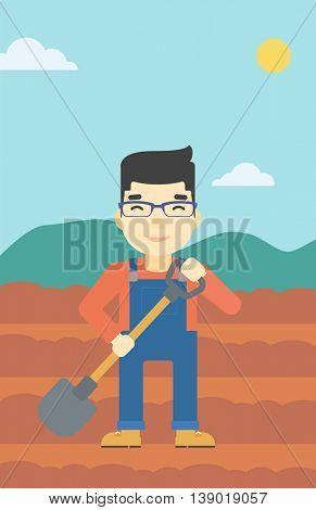 An asian farmer with shovel on the background of plowed agricultural field. Friendly farmer with spade in field. Vector flat design illustration. Vertical layout.
