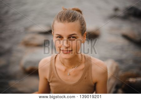 beautiful portrait of a carefree friendly approachable girl with stunning smile and cute looks on beach