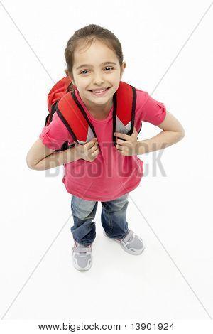 Studio Portrait of Smiling Girl Wearing School Bag