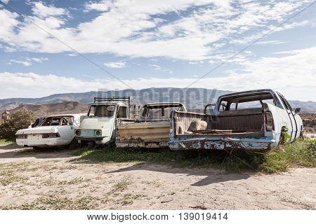 Old abandoned cars left in the desert