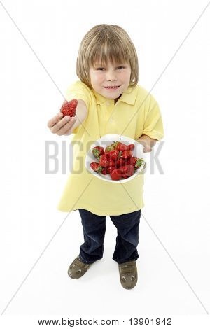 Studio Portrait of Smiling Boy Holding Bowl of Strawberries