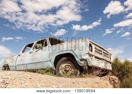 Old abandoned pickup truck in the desert