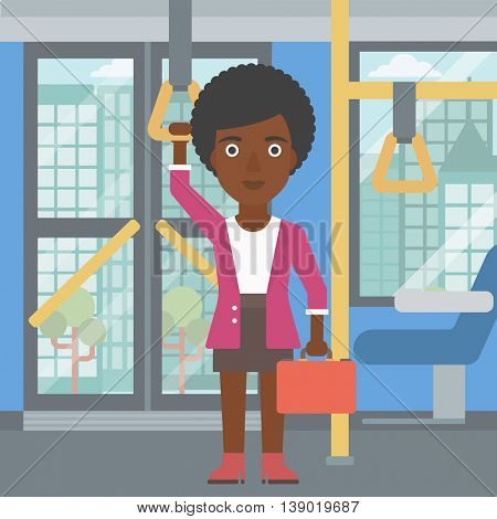 An african-american woman traveling by public transport. Young woman standing inside public transport. Woman traveling by passenger bus or subway. Vector flat design illustration. Square layout.