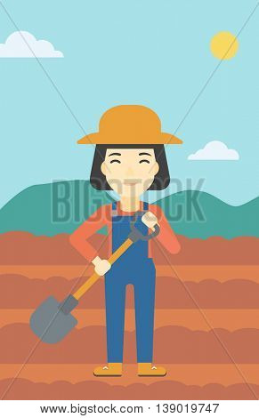 An asian female farmer with shovel on the background of plowed agricultural field. Friendly farmer with spade in field. Vector flat design illustration. Vertical layout.