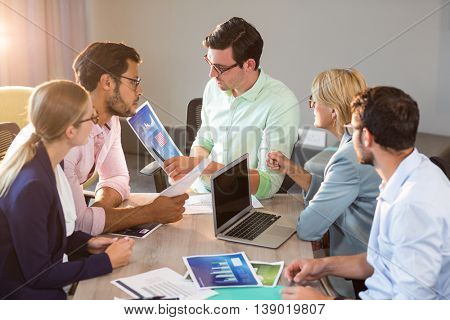 Business people discussing over graph during a meeting in the office