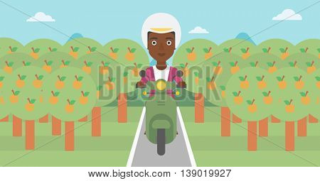 An african-american young woman riding a scooter on the asphalt road through the orchard. Young woman in helmet driving a scooter. Vector flat design illustration. Horizontal  layout.