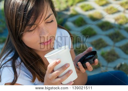 Lady Enjoying Smell Of Fresh Coffee Outside