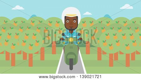 An african-american young man riding a scooter on the asphalt road through the orchard. Young man in helmet driving a scooter. Vector flat design illustration. Horizontal  layout..