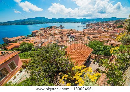 Aerial view over Portoferraio town of Elba island in Italy. It is the largest comune of the province of Livorno on the edge of the eponymous harbour of the island of Elba.