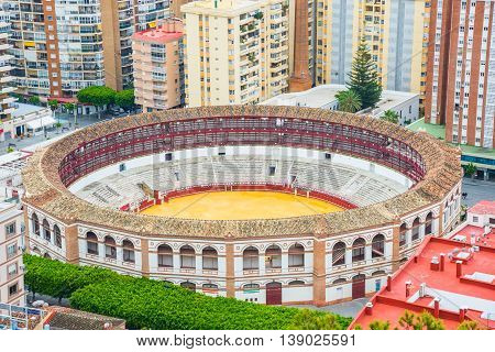 Wide aerial view over the famous bullring stadium arena in Malaga, Andalusia - Spain