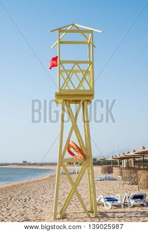 shore on the sand a wooden tower and rescue lifeline