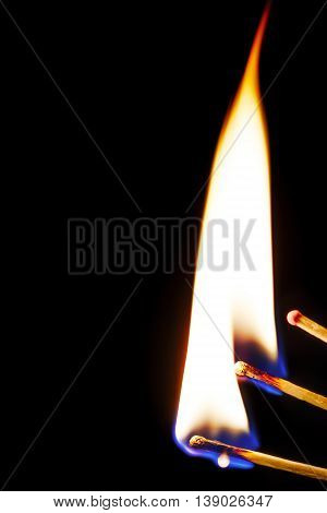 Burning matches isolated on a black background