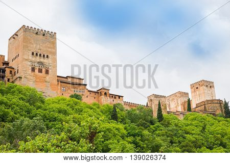 Traditional architecture of the walls and towers of Alhambra Palace, Granada - Spain