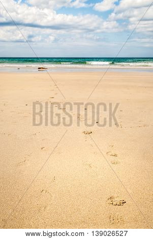 Footsteps In A Sand On A Tropical Beach Near Sea.
