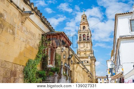 Traditional beautiful architecture of Cordoba city in day time and clouds on the blue sky in Andalusia, Spain