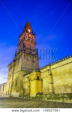 Traditional tower-bell architecture illuminated at night - mosque in Cordoba - Andalusia, Spain