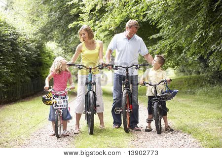 Family riding bikes in countryside