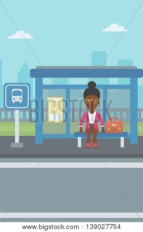 An african-american woman with briefcase waiting for a bus at a bus stop on a city background. Young woman sitting at bus stop at the city street. Vector flat design illustration. Vertical layout.