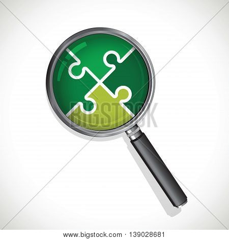 a magnifying glass on a green jigsaw
