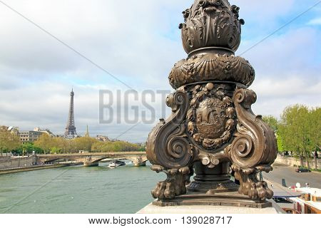 Candelabra on the Alexandre III bridge. Fluctuat nec mergitur, emblem of Paris. (Paris, France)