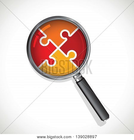 a magnifying glass on a red jigsaw