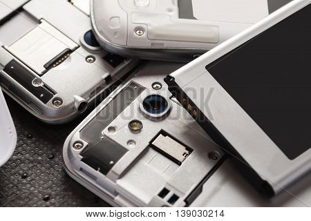 Disassembled cell phone with visible parts inside selective focus