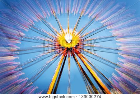 Big wheel on a fun fare, shot taken with intentional camera movement (ICM)