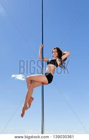 Brunette In Swimsuit On Pylon For Dancing