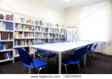 Modern library interior with blue chairs