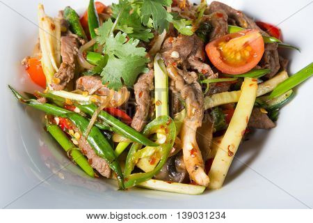 Asian fried meat wok dish served on a white plate