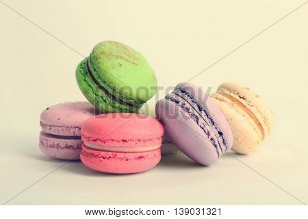 Heap of colorful tasty macaroons on white background