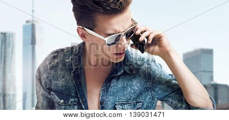 Young handsome man talking over cellphone