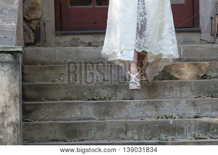 Bride walking down starts in wedding dress