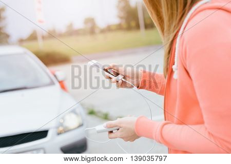 Woman With Phone And Power Bank Playing The Mobile Games