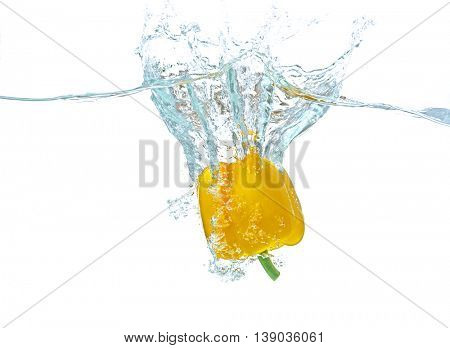 Fresh yellow pepper falling in water on white background
