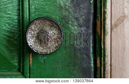 Vintage dirty door handle closeup shot selective focus