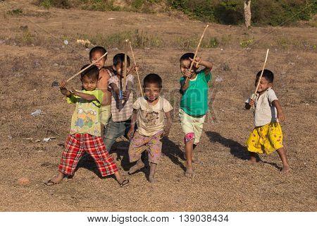 MRAUK-U MYANMAR - JANUARY 26 2016: Unidentified poor but healthy children group portrait outdoors