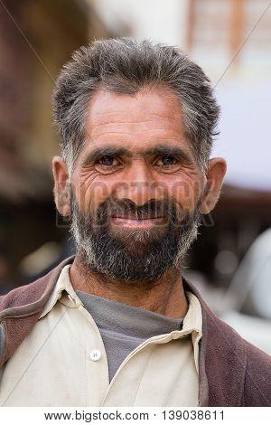 SRINAGAR INDIA - JUNE 21 2015: Unidentified Indian muslim man in the street market