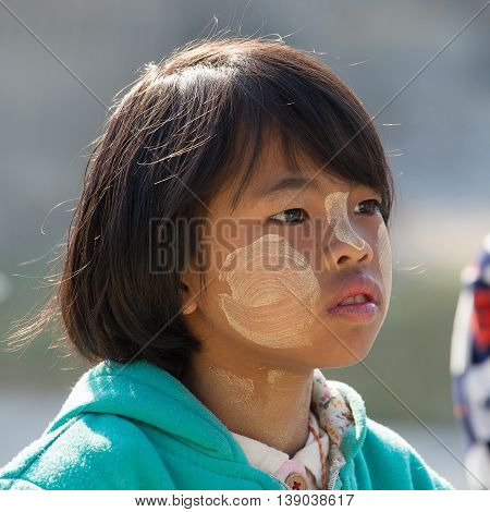 INLE LAKE MYANMAR - JANUARY 13 2016: Unidentified young Myanmar children with thanaka on face in local school.