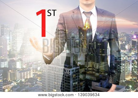 Double exposure of businessman hold the first sign of business and city center of business in hand business concept