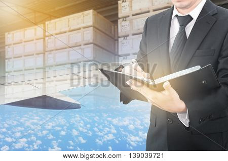 Businessman Writing Notebook With Blurred Cargo In Wooden Case And Export Plane Aeriel Background, E