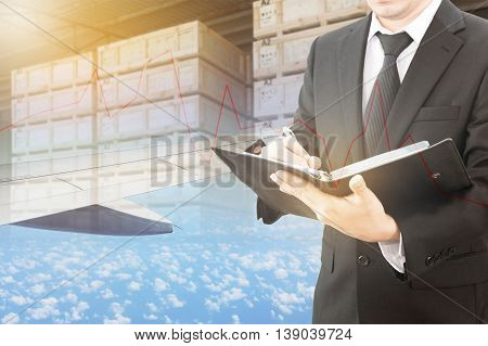 Businessman Writing Notebook With Blurred Cargo In Wooden Case And Plane Background, Trading Export