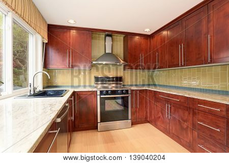 Kitchen Room Interior With Modern Brown Cabinets And Light Tones Hardwood Floor