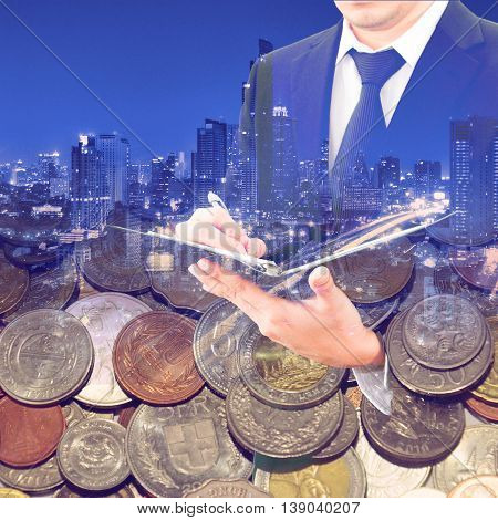 Double Exposure Of Business, Night City And Group Of International Coins For Busines Finance Concept